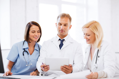 healthcare, medical and technology concept - doctors looking at